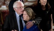 Sen. Bernie Sanders, I-Vt., hugs his wife Jane O'Meara Sanders, during the inaugural luncheon in honor of President Donald Trump at the Statuary Hall in the Capitol, Friday, Jan. 20, 2017, in Washington. (AP Photo/Manuel Balce Ceneta)