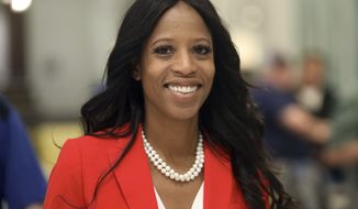 FILE - In this Nov. 6, 2018, file photo, Republican U.S. Rep. Mia Love walks to greets supporters during an election night party, in Lehi, Utah. Love has cut into Democratic challenger Ben McAdams' lead as vote-counting continues in the race that remains too close to call a week after Election Day. (AP Photo/Rick Bowmer, File)