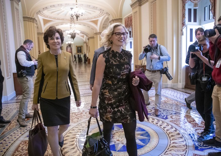 Newly elected Democratic Senators Jacky Rosen of Nevada, left, and Kyrsten Sinema of Arizona, arrive at the Capitol in Washington for a meeting with Senate Minority Leader Chuck Schumer, D-N.Y., Tuesday, Nov. 13, 201816. (AP Photo/J. Scott Applewhite)