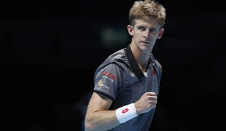 Kevin Anderson of South Africa reacts after winning the first set against Kei Nishikori of Japan during their ATP World Tour Finals tennis match at the O2 arena in London, Tuesday, Nov. 13, 2018. (AP Photo/Alastair Grant)