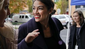 Rep.-elect Alexandria Ocasio-Cortez, D-N.Y., arrives for orientation for new members of Congress, Tuesday, Nov. 13, 2018, in Washington. (AP Photo/Pablo Martinez Monsivais) ** FILE **