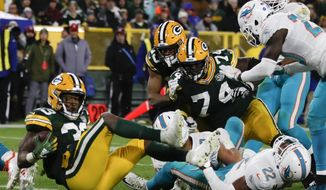 Green Bay Packers' Aaron Jones runs for a touchdown during the second half of an NFL football game against the Miami Dolphins Sunday, Nov. 11, 2018, in Green Bay, Wis. (AP Photo/Matt Ludtke)