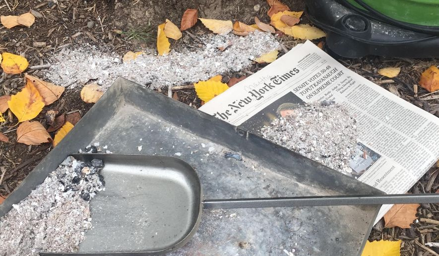 This Oct. 21, 2018 photo of wood stove ashes on a property near Langley, Wash., shows a nutrient-rich sample free of any residue from pressure-treated wood, painted wood or cardboard. They carry chemicals that can damage plants. The same goes for using charcoal from BBQ grills, fake fireplace logs and coal. Good quality wood ash is a soil amendment bonus for gardeners but beware using any containing additives. (Dean Fosdick via AP)