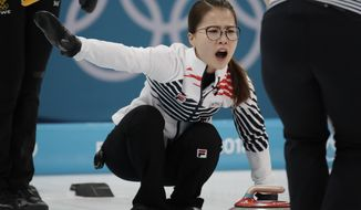 FILE - In this Feb. 25, 2018 file photo, Kim Eun-jung, of South Korea, yells during their women's curling final in the Gangneung Curling Centre at the 2018 Winter Olympics in Gangneung, South Korea. Five-member women's curling team accused former Korean Curling Federation (KCF) vice-president Kim Kyong-doo of verbal abuse and team coaches of giving unreasonable orders and subjecting their private lives to excessive control. (AP Photo/Aaron Favila, File)