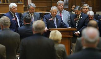 """House speaker David Ralston and House members take a moment before the start of business this morning to remember State Rep. John Meadows, R-Calhoun, who was the chairman of the House Rules Committee, who died, Tuesday, Nov. 13, 2018, in Atlanta. Ralston confirmed Meadows' death and called the seven-term lawmaker """"outwardly fierce and courageous but he was, at the same time, one of the kindest and most generous souls you have ever met."""" (Bob Andres/Atlanta Journal-Constitution via AP)"""