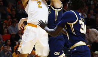 Tennessee forward Grant Williams (2) shoots as he's fouled by Georgia Tech forward Evan Cole (3) during the first half of an NCAA college basketball game Tuesday, Nov. 13, 2018, in Knoxville, Tenn. (AP photo/Wade Payne)