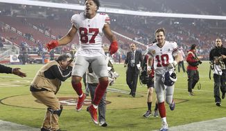 New York Giants wide receiver Sterling Shepard (87) and quarterback Eli Manning (10) celebrate as they run off the field after an NFL football game against the San Francisco 49ers in Santa Clara, Calif., Monday, Nov. 12, 2018. (AP Photo/Tony Avelar)