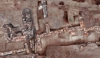 This undated photo provided by the Greek Ministry of Culture on Tuesday, Nov. 13, 2018, shows remains of walls and floors, probably from houses, from the lost ancient city of Tenea. The ministry said Tuesday archaeologists have located the first tangible remains of the city that, according to tradition, was first settled by Trojan war captives after the Greek sack of Troy. (Greek Culture Ministry via AP)