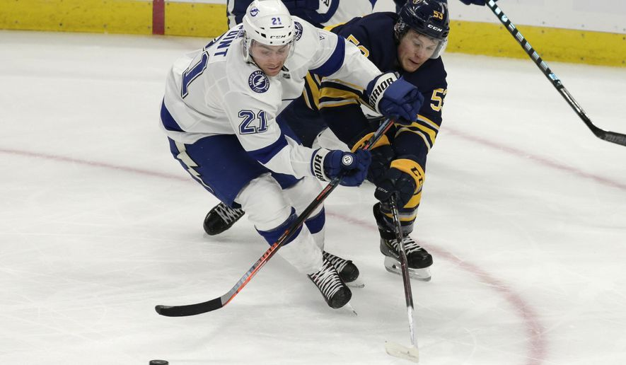 Buffalo Sabres forward Jeff Skinner (53) and Tampa Bay Lightning forward Brayden Point (21) battle for the puck during the first period of an NHL hockey game, Tuesday, Nov. 13, 2018, in Buffalo N.Y. (AP Photo/Jeffrey T. Barnes)