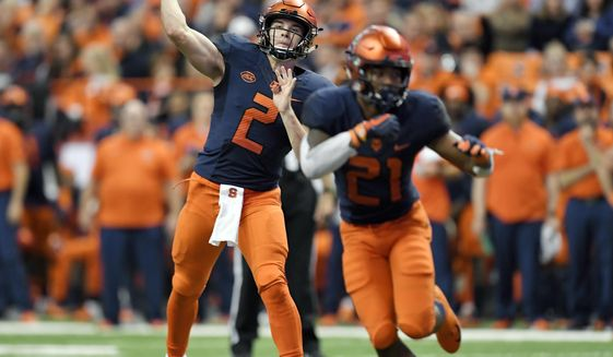 Syracuse quarterback Eric Dungey (2) throws a pass from the pocket during the second half of an NCAA college football game against Louisville in Syracuse, N.Y., Friday, Nov. 9, 2018. (AP Photo/Adrian Kraus)