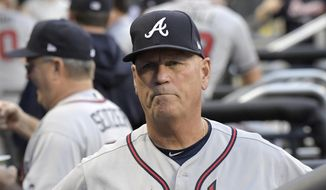 FILE - In this Friday, Aug. 3, 2018 file photo, Atlanta Braves manager Brian Snitker looks on from the dugout before a baseball game against the New York Mets in New York. Atlanta's Brian Snitker has been voted National League Manager of the Year after leading the Braves to a surprising first-place finish. Snitker received 17 first-place votes, nine seconds and one third for 116 points from the Baseball Writers' Association of America in balloting announced Tuesday, Nov. 13, 2018.(AP Photo/Bill Kostroun, File) **FILE**