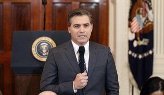 In this Nov. 7, 2018, file photo, CNN journalist Jim Acosta does a standup before a new conference with President Donald Trump in the East Room of the White House in Washington. (AP Photo/Evan Vucci, File) **FILE**