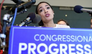 Rep.-elect Alexandria Ocasio-Cortez, D-N.Y., talks during a news conference with members of the Progressive Caucus in Washington, Monday, Nov. 12, 2018. (AP Photo/Susan Walsh)