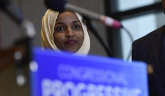 Rep.-elect Ilhan Omar, D-Minn., listens during a news conference with members of the Progressive Caucus in Washington, Monday, Nov. 12, 2018. (AP Photo/Susan Walsh)