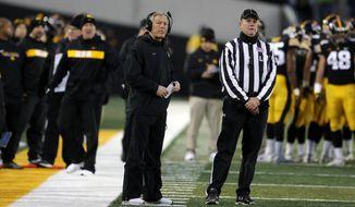 Iowa head coach Kirk Ferentz, left, watches a replay during the second half of an NCAA college football game against Northwestern, Saturday, Nov. 10, 2018, in Iowa City, Iowa. Northwestern won 14-10. (AP Photo/Charlie Neibergall)