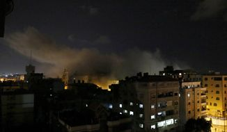 Smoke rises after an Israeli airstrike hit Hamas' Al-Aqsa TV station in the Gaza Strip, Monday, Nov. 12, 2018. The station went off the air after the airstrike. Minutes earlier, it had halted its programming and been broadcasting a still image of its logo after the building was hit by a warning missile. Shortly after, three loud explosions were heard and the screen turned black. (AP Photo/Hatem Moussa)