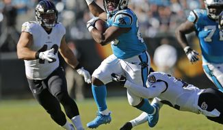 FILE - In this Sunday, Oct. 28, 2018 file photo, Carolina Panthers' C.J. Anderson (20) runs as Baltimore Ravens' Patrick Ricard (42) defends in the second half of an NFL football game in Charlotte, N.C. The Carolina Panthers waived running back C.J. Anderson, who was a 1,000-yard rusher in 2017 for the Denver Broncos. (AP Photo/Nell Redmond, File)