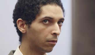 In this May 22, 2018, file photo, Tyler Barriss, of California, appears for a preliminary hearing in Wichita, Kan. Barriss is accused of making a hoax phone call that led police to fatally shoot an unarmed man in Wichita, Kan., in December 2017. Barris is set to change his plea in federal court. (Bo Rader/The Wichita Eagle via AP, File)