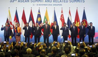 ASEAN Leaders pose for a group photo during the opening ceremony for the 33rd ASEAN Summit and Related Summits Tuesday, Nov. 13, 2018, in Singapore. From left; Prime Minister Mahathir Mohamad of Malaysia, Myanmar Leader Aung San Suu Kyi, President Rodrigo Duterte of The Philippines, Prime Minister Nguyen Xuan Phuc of Vietnam, Prime Minister Lee Hsien Loong of Singapore, Prime Minister Prayuth Chan-ocha of Thailand, Sultan Hassanal Bolkiah of Brunei, Prime Minister Hun Sen of Cambodia, President Joko Widodo of Indonesia and Prime Minister Thongloun Sisoulith of Laos. (AP Photo/Bullit Marquez)