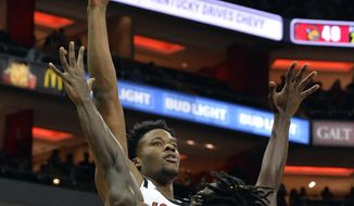 Louisville center Steven Enoch (23) shoots over Southern forward Bryan Assie (21) during the second half of an NCAA college basketball game, in Louisville, Ky., Tuesday, Nov. 13, 2018. Louisville won 104 - 54. (AP Photo/Timothy D. Easley)