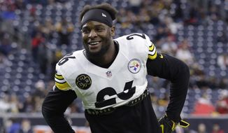FILE - In this Dec. 25, 2017, file photo, Pittsburgh Steelers running back Le'Veon Bell (26) warms up before an NFL football game against the Houston Texans, in Houston. The Le'Veon Bell watch is almost over for the Steelers. The star running back has until 4 p.m. on Tuesday, Nov. 13, 2018, afternoon to sign his one-year franchise tender and be eligible to play this season. (AP Photo/Michael Wyke, FIle) **FILE**