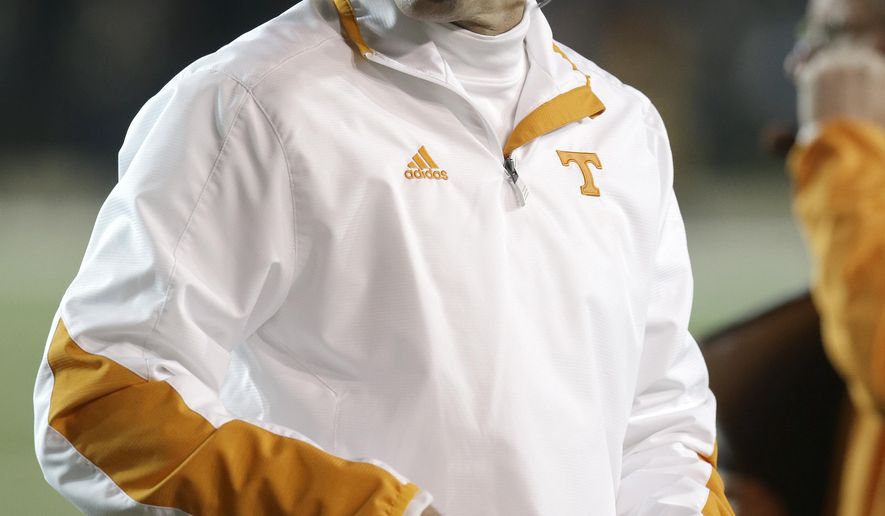 FILE - In this Nov. 17, 2012, file photo, Tennessee head coach Derek Dooley walks the sideline in an NCAA college football game against Vanderbilt in Nashville, Tenn. Dooley, now offensive coordinator at Missouri, says he has no hard feelings toward Tennessee as he prepares for his return to Knoxville. Missouri plays Tennessee on Saturday, Nov. 17, 2018.(AP Photo/Mark Humphrey, File)