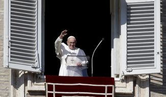 Pope Francis waves as he arrives to recite the Angelus noon prayer from the window of his studio overlooking St.Peter's Square, at the Vatican, Sunday, Nov. 11, 2018. (AP Photo/Alessandra Tarantino)