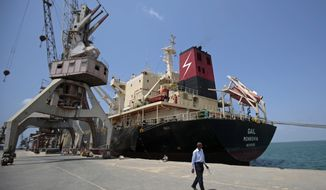 FILE - In this Sept. 29, 2018 file photo, a cargo ship is docked at the Red Sea port city, of Hodeida, Yemen. Yemeni officials said Tuesday, Nov. 13, 2018, that an informal agreement to reduce hostilities between Saudi-led coalition forces and rebels in and around Hodeida has taken hold. They said that hostilities have ceased for the past 24 hours, with both sides respecting the truce. The truce followed advances by the coalition in their latest attempt to retake the city from the Shiite rebels, known as Houthis. (AP Photo/Hani Mohammed, File)