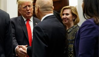 Deputy National Security Adviser Mira Ricardel, right, watches as President Donald Trump arrives for a Diwali ceremonial lighting of the Diya in the Roosevelt Room of the White House, Tuesday, Nov. 13, 2018, in Washington. (AP Photo/Evan Vucci)