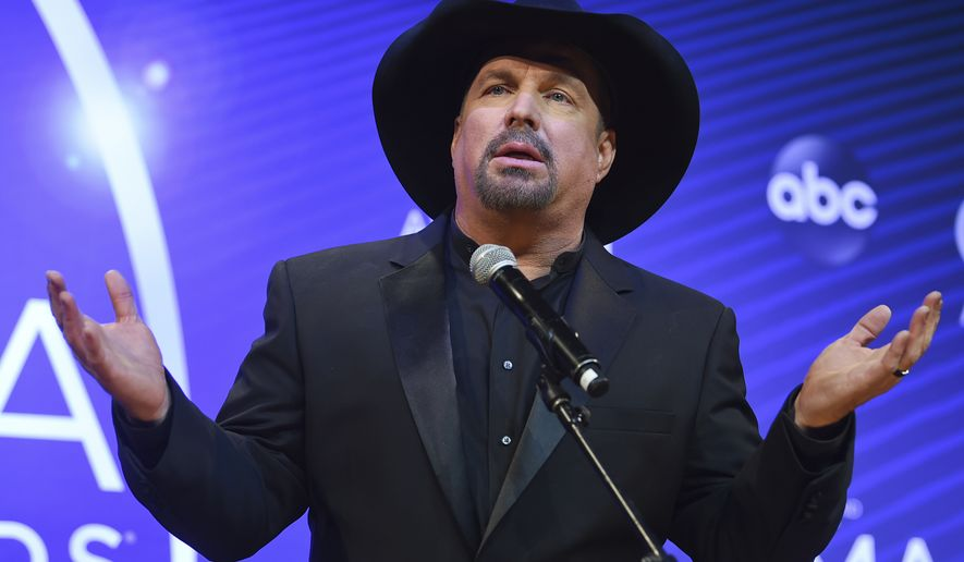 Singer/songwriter Garth Brooks takes questions in the press room at the 52nd annual CMA Awards at Bridgestone Arena on Wednesday, Nov. 14, 2018, in Nashville, Tenn. (Photo by Evan Agostini/Invision/AP)