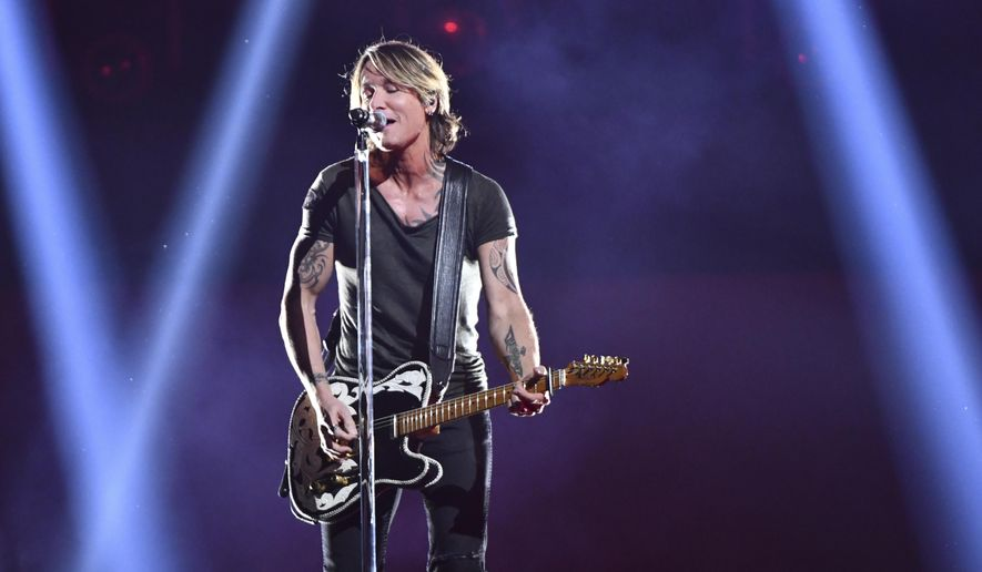 """Keith Urban performs """"Never Comin' Down"""" at the 52nd annual CMA Awards at Bridgestone Arena on Wednesday, Nov. 14, 2018, in Nashville, Tenn. (Photo by Charles Sykes/Invision/AP)"""
