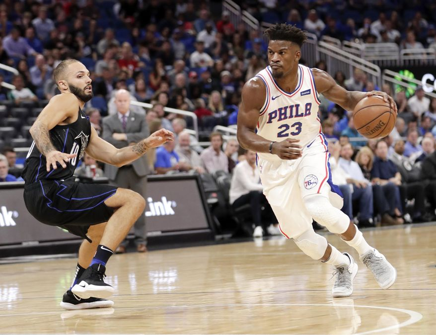 Philadelphia 76ers' Jimmy Butler (23) drives past Orlando Magic's Evan Fournier during the first half of an NBA basketball game Wednesday, Nov. 14, 2018, in Orlando, Fla. (AP Photo/John Raoux)