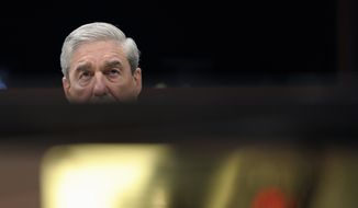 FBI Director Robert Mueller testifies on Capitol Hill in Washington, Thursday, Feb. 2, 2012, before the House Intelligence Committee hearing on worldwide threats. (AP Photo/Cliff Owen) **FILE**