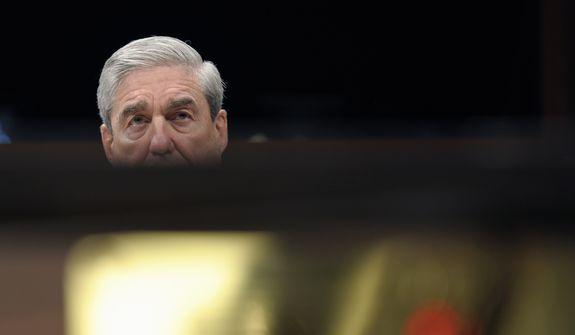 FBI Director Robert Mueller testifies on Capitol Hill in Washington, Thursday, Feb. 2, 2012, before the House Intelligence Committee hearing on worldwide threats. (AP Photo/Cliff Owen) **FILE**
