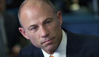 FILE - In this Thursday, May 10, 2018, file photo Michael Avenatti, is interviewed in New York. Avenatti is in police custody in Los Angeles following domestic violence allegation. (AP Photo/Mark Lennihan, File)