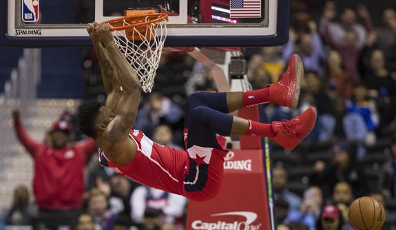 Washington Wizards center Dwight Howard dunks the ball during the first half of an NBA basketball game against the Cleveland Cavaliers, Wednesday, Nov. 14, 2018, in Washington. (AP Photo/Alex Brandon)