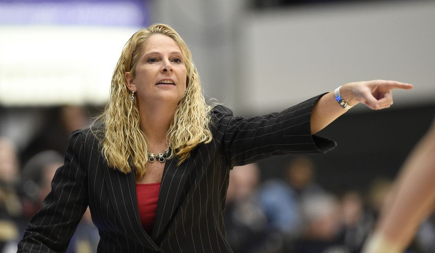 Maryland head coach Brenda Frese points during the second half of an NCAA college basketball game against George Washington, Wednesday, Nov. 14, 2018, in Washington. Maryland won 69-30. (AP Photo/Nick Wass) **FILE**