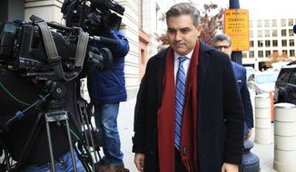 """CNN's Jim Acosta walks into federal court in Washington, Wednesday, Nov. 14, 2018, to attend a hearing on legal challenge against President Donald Trump's administration. Trump's administration contends it has """"broad discretion"""" to regulate press access to the White House as it fends off a legal challenge from CNN and other outlets over the revocation of Acosta's """"hard pass."""" (AP Photo/Manuel Balce Ceneta)"""