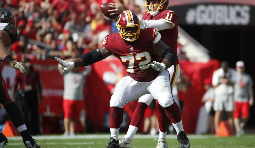 Washington Redskins offensive guard Jonathan Cooper (72) sets to block against the Tampa Bay Buccaneers during an NFL football game Sunday, Nov. 11, 2018, in Tampa, Fla. The Redskins won the game 16-3. (Jeff Haynes/AP Images for Panini) ** FILE **