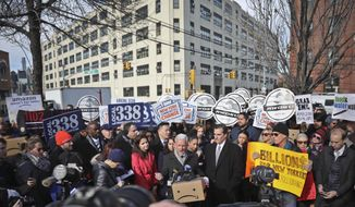 New York City Councillor Jimmy Van Bramer, center, speaks during a coalition rally and press conference of elected officials, community organizations and unions opposing Amazon headquarters getting subsidies to locate in the New York neighborhood of Long Island City, Queens, Wednesday Nov. 14, 2018, in New York. (AP Photo/Bebeto Matthews)