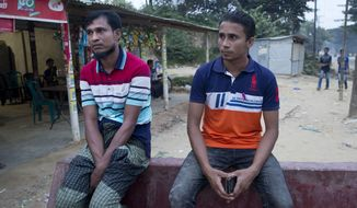 "Rohingya Muslims Nurul Amin, 35, left, and Mohammed Selim, 23, whose names are on the first list to be repatriated back to Myanmar, talk to the Associated Press outside Jamtoli refugee camp, in Bangladesh, Wednesday, Nov. 14, 2018. Bangladesh authorities said they are ready to begin repatriating some of the more than 700,000 Rohingya Muslims who have fled from army-led violence in Myanmar since last year, but refugees scheduled to leave said they would refuse to go because of fears for their safety. ""I will not go. My wife and other family members have gone elsewhere, they do not want to go,"" Amin told The Associated Press. Selim said his wife and seven other family members went into hiding after finding out that they would be sent back Thursday. (AP Photo/Dar Yasin)"