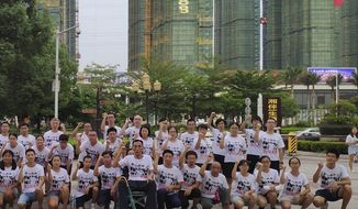 In this photo provided by the Jasic Workers Support Group and taken Aug 2018, members of the Jasic Workers Support Group pose for a group photo after a campaign promoting worker's rights in Dezhou city in Guangdong province. Students and alumni of several Chinese universities are sounding the alarm over the apparent detention of more than a dozen young labor activists including Zhang Shengye, a recent graduate of Peking University, seen at the right standing row, who have been missing since the weekend. (Jasic Workers Support Group via AP)