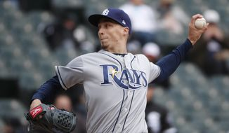 FILE - In this April 10, 2018, file photo, Tampa Bay Rays starting pitcher Blake Snell delivers during the third inning of a baseball game against the Chicago White Sox in Chicago. Snell was announced as the winner of the American League Cy Young Award on Wednesday, Nov. 14, 2018. (AP Photo/Jeff Haynes, File) **FILE**