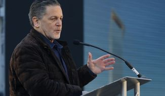 FILE - In this Dec. 14, 2017, file photo, Quicken Loans founder Dan Gilbert, addresses attendees at the former site of the J.L. Hudson Co. department store, in Detroit. Gilbert has reached an agreement to sell Greektown Casino-Hotel in downtown Detroit for $1 billion. Gilbert's Detroit-based JACK Entertainment said Wednesday, Nov. 14, 2018, it planned to sell the casino to Pennsylvania-based Penn National and New York-based VICI Properties. (AP Photo/Carlos Osorio, File)