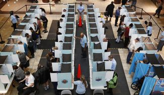 FILE--In this Nov. 6, 2018, file photo, people vote in Henderson, Nev. Democrats will have a supermajority in the Nevada state Assembly next year but have fallen 24 votes short in one legislative race that's keeping them from a supermajority in the state Senate, according to final but unofficial results released Wednesday, Nov. 14, 2018, in Clark County. (AP Photo/John Locher, file)