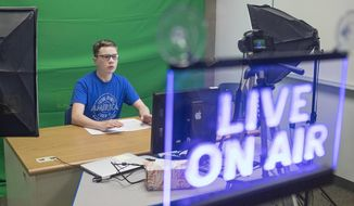 """Adam Engel records his show """"Mingle with Engel"""" on a recent Monday, Oct 22, 2018 morning at Thunder Basin High School. Engel then edits the footage to be shown with the school's news program on Tuesdays. (Rhianna Gelhart/Gillette News Record via AP)"""