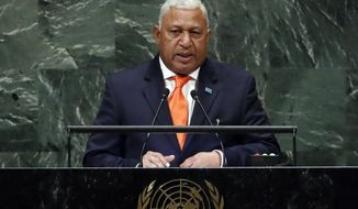 FILE - In this Friday, Sept. 28, 2018, file photo, Fiji's Prime Minister Josaia Voreqe Bainimarama addresses the 73rd session of the United Nations General Assembly, at U.N. headquarters, in New York. Opinion polls indicate Bainimarama is poised to win a second term in Fiji's general election Wednesday after he first held democratic elections in 2014, eight years after he seized power in a coup. (AP Photo/Richard Drew, File)