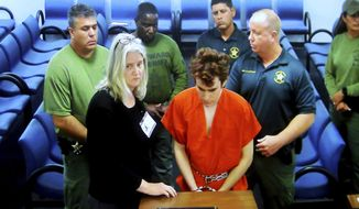 Florida school shooting suspect Nikolas Cruz appears in court via video with public defender Diane Cuddihy in Fort Lauderdale, Fla., Wednesday, Nov. 14, 2018. Cruz attacked a detention officer at the county jail and now faces new charges including use of the officer's electric stun device, authorities said Wednesday. (Mike Stocker/South Florida Sun-Sentinel via AP)