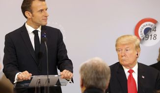 French President Emmanuel Macron delivers a speech while President Donald Trump looks on before a lunch at the Elysee Palace, in Paris, as part of the commemorations marking the 100th anniversary of the 11 November 1918 armistice, ending World War I, Sunday, Nov. 11, 2018. (Jacques Demarthon/Pool Photo via AP)