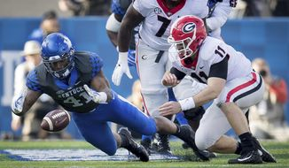 Kentucky linebacker Josh Allen (41) dives on the fumble of Georgia quarterback Jake Fromm (11) during the first half an NCAA college football game in Lexington, Ky., Saturday, Nov. 3, 2018. (AP Photo/Bryan Woolston)